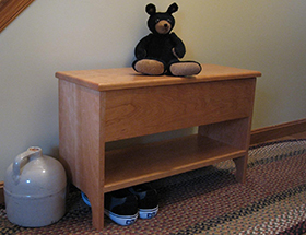 Storage bench with shelf in cherry