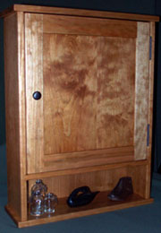 cherry medicine cabinet with open shelf
