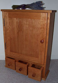 cherry medicine cabinet with apothecary styled drawers